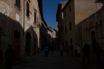 3-stops under exposed. San Gimignano, Italy, tourists, tourist attraction, hill town, Tuscany, Italy