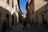 1-stop under exposed. San Gimignano, Italy, tourists, tourist attraction, hill town, Tuscany, Italy
