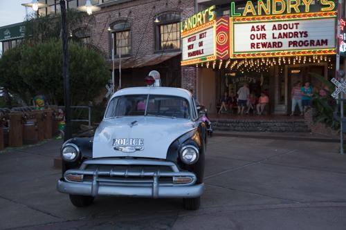 Landry's restaurant, 1950 police car, tourists, tourist attraction, Kemah Boardwalk, Kemah, Texas.