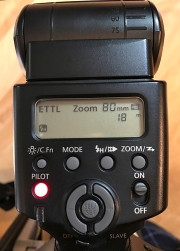 Canon 430 flash showing ETTL and Zoom settings.
